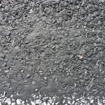 Bleeding of existing bitumen seal